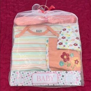 A baby set - hat, onesie, and a baby bib